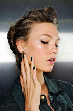 / dark green (almost black) nail polish