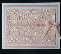 This card was made using a Anna Griffin (Foulard) embossing folder and a Cuttlebug.
