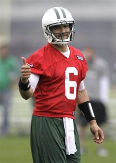 New York Jets quarterback Mark Sanchez gestures after making a throw during NFL football practice, Thursday, May 24, 2012, in Florham Park, N.J.