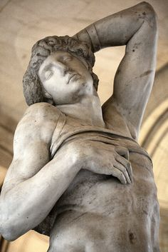 "Slave by Michelangelo. 1513-1516 Paris, Louvre. Did you know: The slave's left wrist is strapped to the back of the neck, and there is a band around his chest. A monkey, only partially carved, grasps his left shin, representing either art as mere ""aping"" (mimesis) or suggesting earthly passions. The artist and work were influenced by the late BC Rhodian sculpture Laocoön and His Sons."