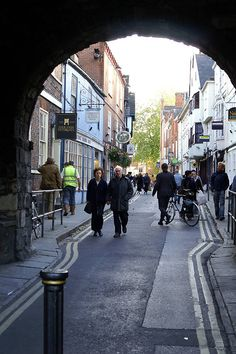 In the medieval, walled city of York, streets that lead to openings in the city walls are called gates. The entrances through the walls are called bars.    Here, High Petergate winds into the center of the city from Bootham Bar, one of the oldest entrances to York.