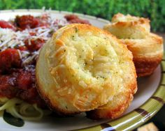 Garlic Roll Cupcakes   1 can ref. breadsticks of 12,  Mix: 1/4 c butter, 1 t. garlic bread seas. , 1 T. Parm cheese  spread on each bread stick.  Roll up and put on each.  Put in 12 cupcake tins and sprinkle with more Parm.  Bake 400* 12-15 mins.