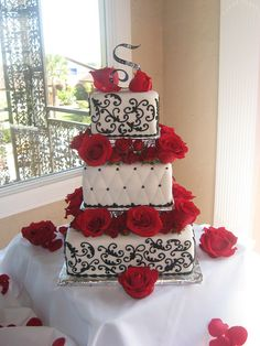 White, Black and Red Roses Wedding Cake by 3 Sisters Chocolate, via Flickr I love the middle tier
