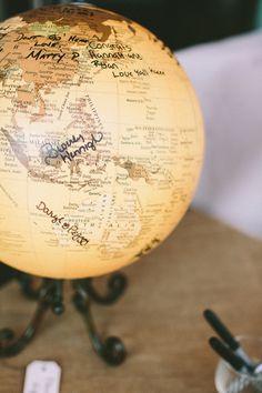 wedding guestbook ideas, signing a globe. so cute! http://www.weddingchicks.com/2013/09/03/rubywood-house/