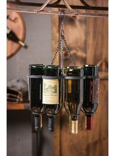 "Hanging Metal Wine Bottle Holder for $67.50 from WineRacks.com  Dimensions: 13.8 w x 7"" d x 18.75"" h Capacity: 6 bottles  This unique hanging rack stores your wine upside down in rustic metal frame."