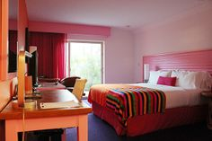 Cheerful pink bedroom at the Saguaro hotel in Palm Springs