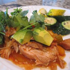 Seriously yummy everyday paleo recipe.  Slow Cooked Pollo Con Salsa Roja  3 lbs boneless skinless organic free range chicken thighs  1 yellow onion sliced  7 celery stalks diced  2 cups baby carrots  28 oz can of El Pato Salsa Para Enchiladas  Juice from 1 lemon  4 cloves of garlic  minced  1 bunch of cilantro chopped  2 avocados diced  In the bottom of your slow cooker, layer the carrots, celery, and onions and top with the minced garlic.  On top of the veggies layer your chicken, squeeze the lemon juice over the chicken, and pour the entire contents of the El Pato sauce on top.  Cook on low all day (6-8 hours).  Serve topped with the diced avocado and cilantro.