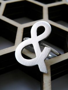 Ampersand ring. She also makes anchor earrings. Clearly this craftsperson is my homegirl.