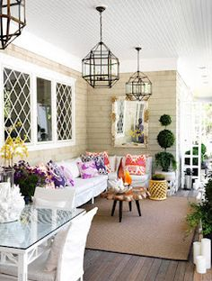 THIS PORCH IS DIVIDED INTO A SIT DOWN EATING SECTION AND A SMALL FAMILY SITTING AREA.