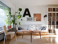 plant, modern living rooms, interior, coffee tables, big letters, record storage, record collection, live room, light