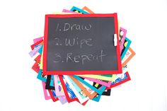 Chalkboard mat - chalkboard fabric on one side, oilcloth on the other to use as a placemat.