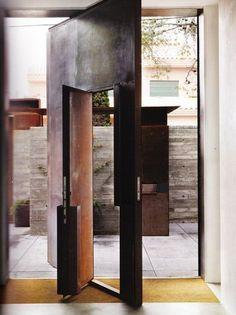 dual pivot door - Olson Kundig Architects - Studio Sitges, Spain