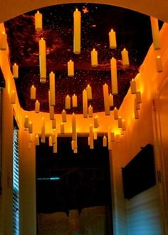 How To Create- Floating Candles like in the Great Hall in Hogwarts - Paper towel tubes, hot glue used to make the edges look like dripping wax, paint the whole tube white and glue an LED candle in the top, seal bottom, hang with fishing sting - glue to the top of the LED flame and tape to the ceiling.