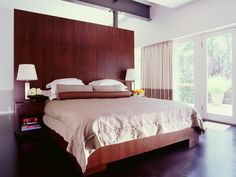 Wooden tall built in headboards designs for king bed size with hardwood floors