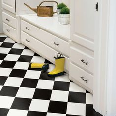 Black and white vinyl composition tile (VCT) give this mudroom a fresh retro look. | Photo: Courtesy of Mannington | thisoldhouse.com
