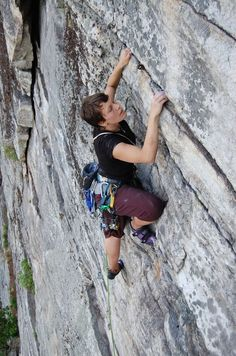 Climber on the Gunks classic Limelight (5.7). Note the old pin just above her head.