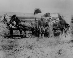 Fascinating vintage photo of a family of settlers with their horses and covered wagon.