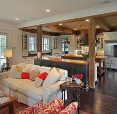 Open floor plan. Bar and beams to separating eating area.