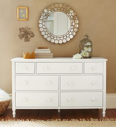 Add touches of gold with our Gold Circle Blossom Mirror