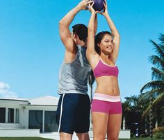 Couples Workout: Team Up to Slim Down. Give and Take: Work shoulders, back, abs, butt and legs with this move. Stand back-to-back, about a foot apart. One person holds ball overhead while the other raises hands, ready to receive ball. After ball is passed, both bend forward, pass ball through legs and return to start for one rep. #SelfMagazine