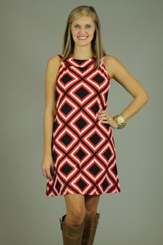 Can you say ADORABLE??? The fit of this dress is amazing…great for anyone! The print gives this dress a super expensive look. With the soft, non-clingy material, you will find yourself wearing this cute little number over and over! The dress also features a side pocket with tiny gold zipper..doesn't get much better than that folks. Colors are red, bla...