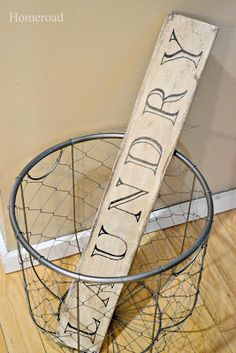 driftwood laundry sign - great tutorial on a cool technique to transfer letters into wood.