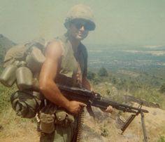 Spc. 4 Leslie H. Sabo Jr. carries the M-60 machine gun in 1969.