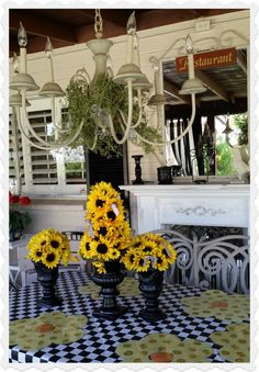 Why have a boring backyard? I love this black and white patio theme with chandelier from Mom Off Track. #porch