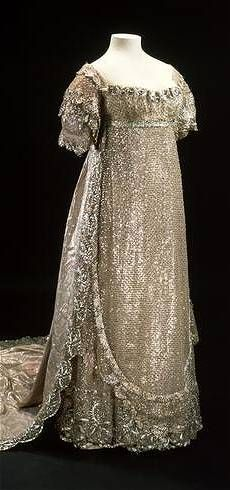 Princess Charlotte's wedding dress,  1816. White silk net, embroidered in  silver strip, trimmed with silver lace.  Museum of London collection