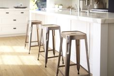 Rejuvenation Kitchen: Industrial-inspired metal stools make a great perch