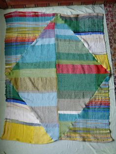 "Travis Meinolf/""Action Weaver"" has cut up handwoven  fabrics & pieced them together in an angular pattern for a blanket  __ photo via his Flickr page"