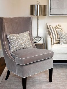 Love the piping on this gray chair