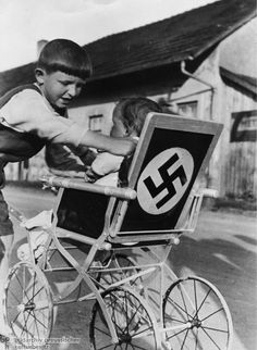 Swastika Stroller in a Lower Bavarian Village (1937) When it came to Hitler portraits and other Nazi symbols, no article from everyday life was off-limits. Symbols of loyalty and unity were supposed to help Nazi propaganda to permeate all areas of life.