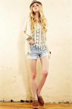 The shorts crafted in denim, featuring embroidery lace embellishment, raw edge,in mini length cut.$68