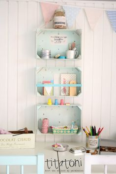 Creative Work Place ♥ I did something similar to this in my kitchen with my old clementine boxes.  I didn't paint them though.  I picked out boxes I liked.