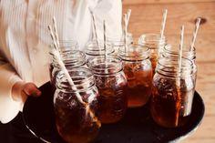 mason jars, paper straws, and sweet tea