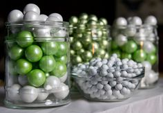 One easy way to incorporate a color theme into a candy buffet is to layer candy in glass vessels. This pin includes shimmer sixlets & gumballs.