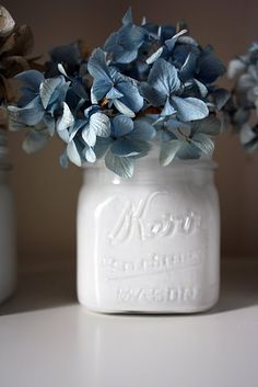 Painted white mason jars and dried hydrangeas!