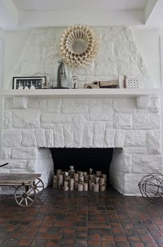 mini tree stumps in fireplaces with candles on top. how lovely would it look with some of the trees spray painted- gold, silver, platinum...