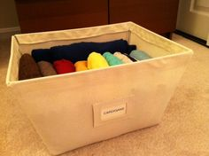 Organize your cardigans by filing them! This makes it so easy to access them and avoids the crumpled mess that used to occupy this bin. Click the photo for how to do this! #organizing #closet #cardigans #sweaters