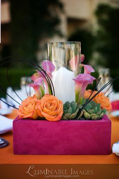 Pink and orange centerpiece, with candle and succulent accents