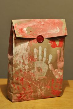 Child hand prints for valentine gift bags
