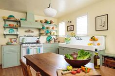 See how a vintage stove and sink help a couple create a kitchen that's in sync with their 1930s house.   Photo: Jill Connors   thisoldhouse.com