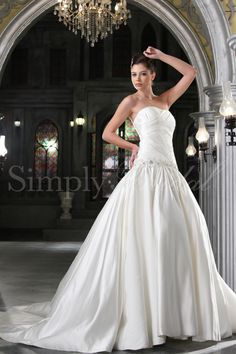 A-line / Ball gown with strapless, straight neckline. Chapel train. Lace-up back.