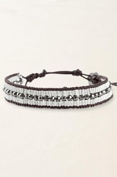 Silver plated sparkly metallic beads on silk thread and a leather cord. $34
