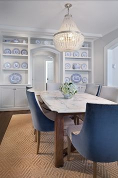 Dining Room Decor Ideas. Inspiring dining room with gray wall, white custom built-in and blue and white decor. #DiningRoom #BlueandWhiteDeco...