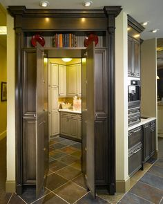 Hidden laundry room off kitchen. Love this idea!