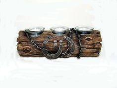 candle log with barbwire and horseshoes from www.outlawandcowgirldecor.com