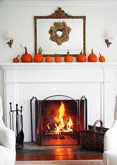 Simple fall decor...pumpkins on the mantel.  #autumn #interior #fireplace
