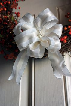 The Sassy Pepper: How to Make a Floral Bow for 1 dollar. Nice for a wreath.